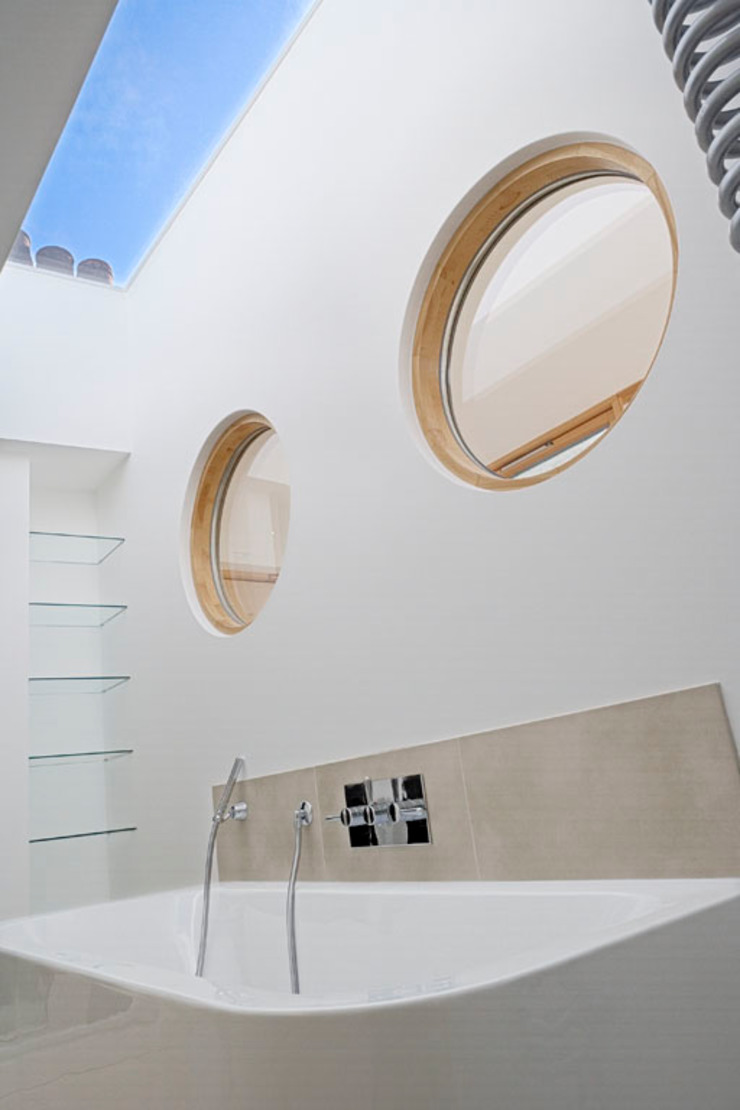 Circular windows in bathroom The Chase Architecture Modern Bathroom White