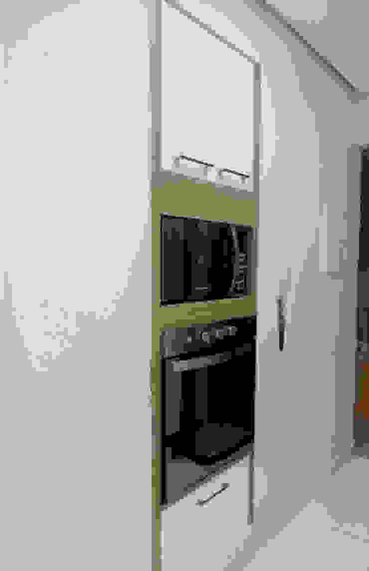 Dois Ambientes Cozinhas modernas por Odete Brito Moderno