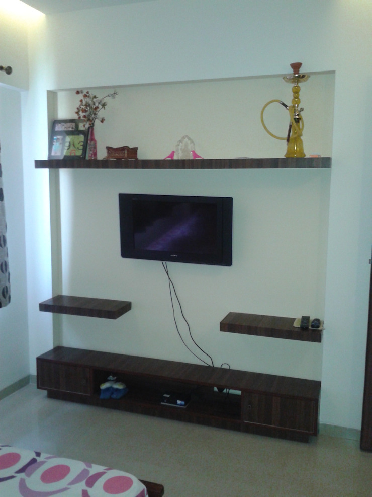 TV unit in the Guest Room Modern style bedroom by Global Associiates Modern