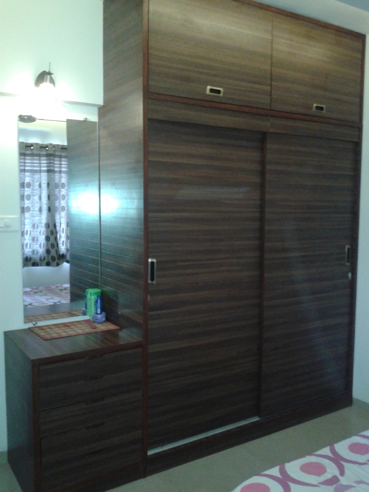 Dresser along with the wardrobe Modern style bedroom by Global Associiates Modern