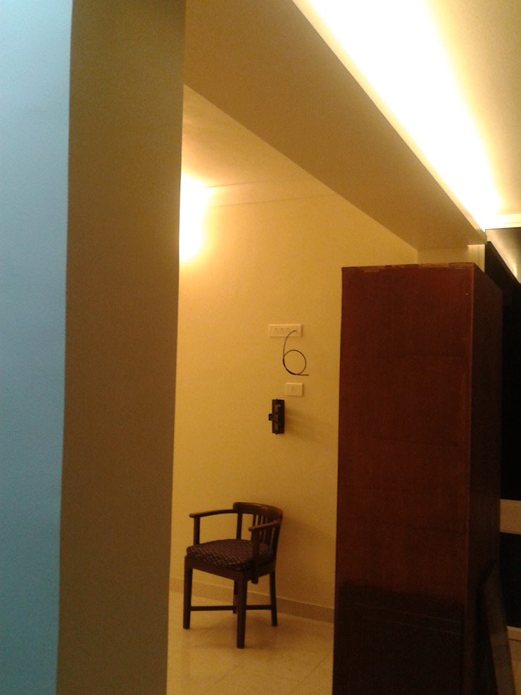 Re-modelling a part of the apartment of the largest book retailer of Pune Minimalist bedroom by Global Associiates Minimalist