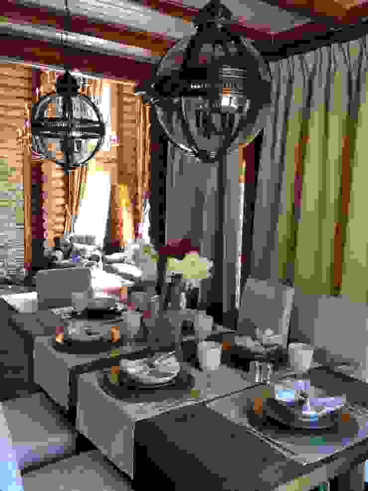Salas de jantar rústicas por Ольга Куликовская-Эшби Rústico