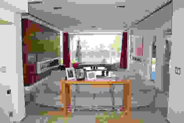 vivienda unifamiliar Salas de estilo moderno de cm espacio & arquitectura srl Moderno