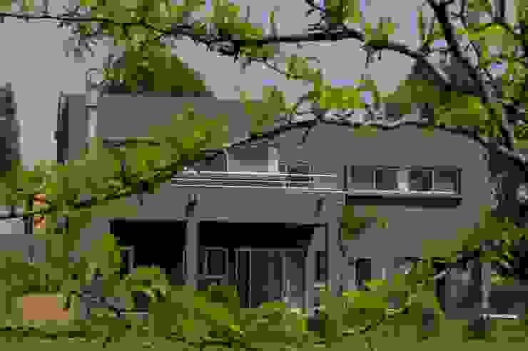 Casas de estilo  por Remy Arquitectos, Minimalista