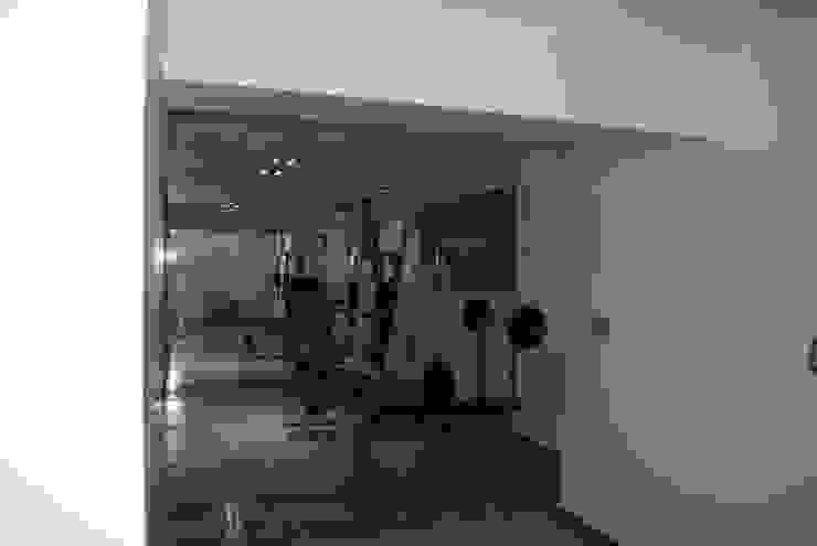 vivienda unifamiliar Gimnasios en casa de estilo moderno de cm espacio & arquitectura srl Moderno