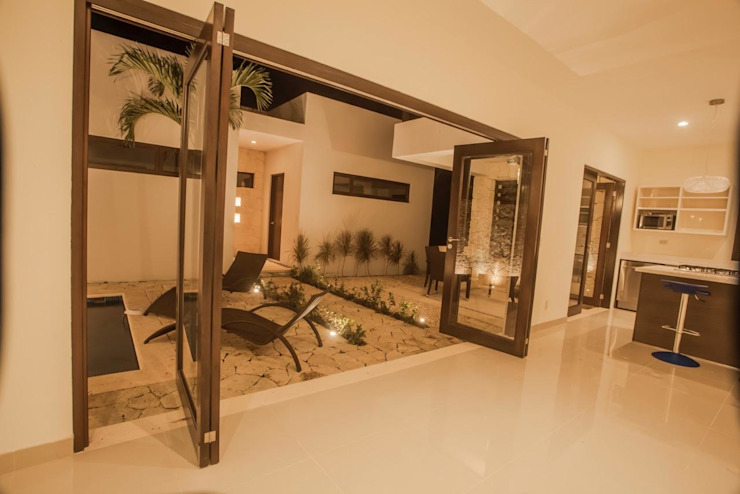 Casa Zama Balcones y terrazas modernos de IURO Moderno