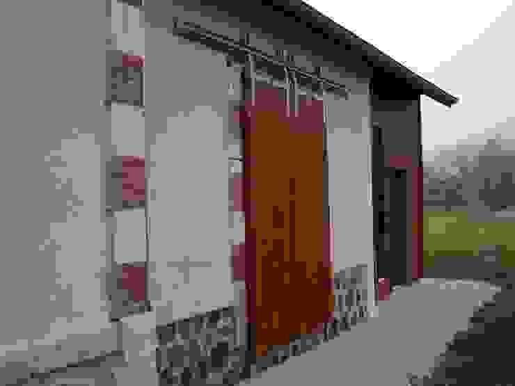 Rénovation des façades existantes Kauri Architecture Maisons rurales