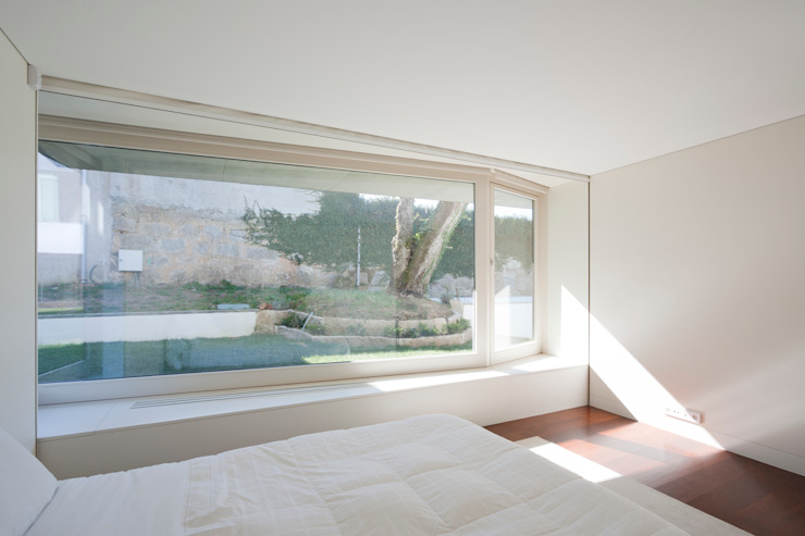 Figueiredo+Pena의  침실, 미니멀