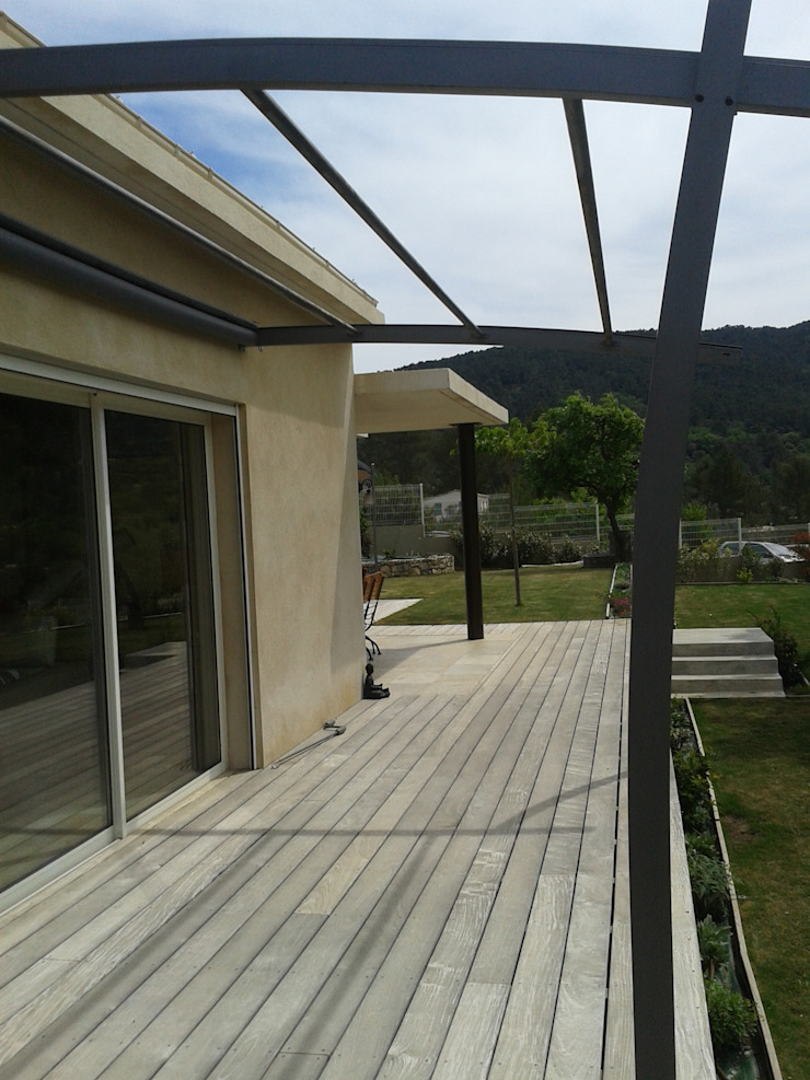 by agence d'architecture nadia poss Modern Wood Wood effect