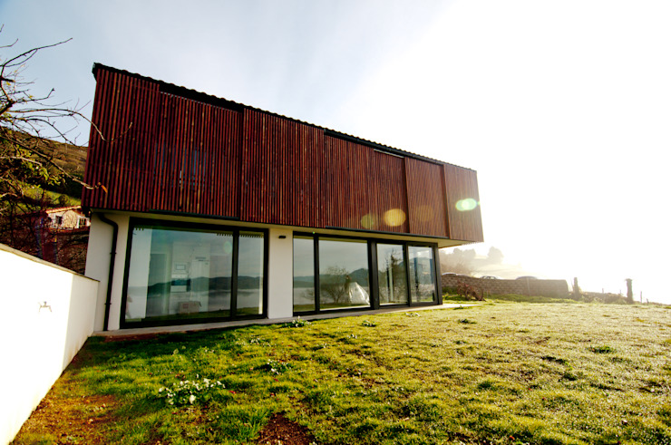 Country style houses by RUBIO · BILBAO ARQUITECTOS Country Wood Wood effect