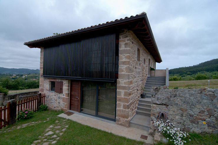 Дома в стиле кантри от RUBIO · BILBAO ARQUITECTOS Кантри