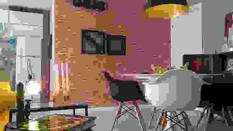 Móveis de design assinados definem a sala de jantar.: Sala de jantar  por Lucio Nocito Arquitetura e Design de Interiores