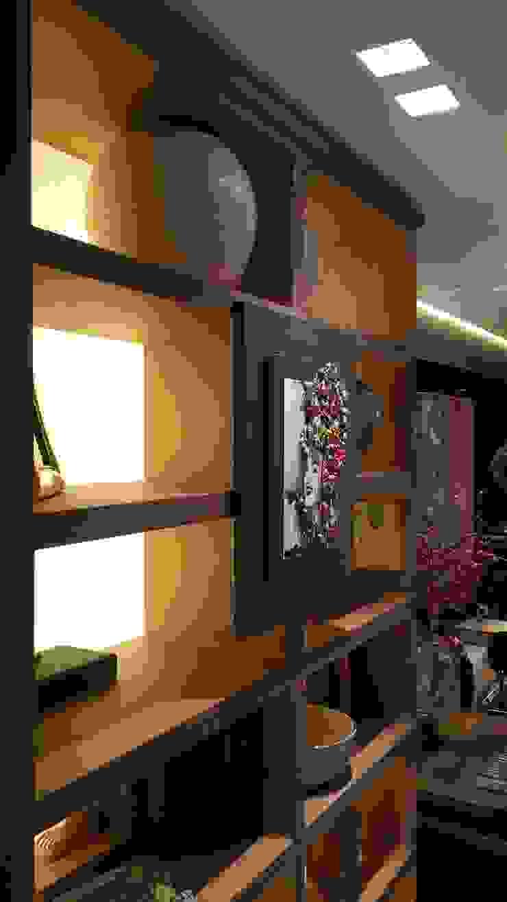 Estante projetada para o ambiente com iluminação indireta. Muito charme conferido ao ambiente. por Lucio Nocito Arquitetura e Design de Interiores Moderno