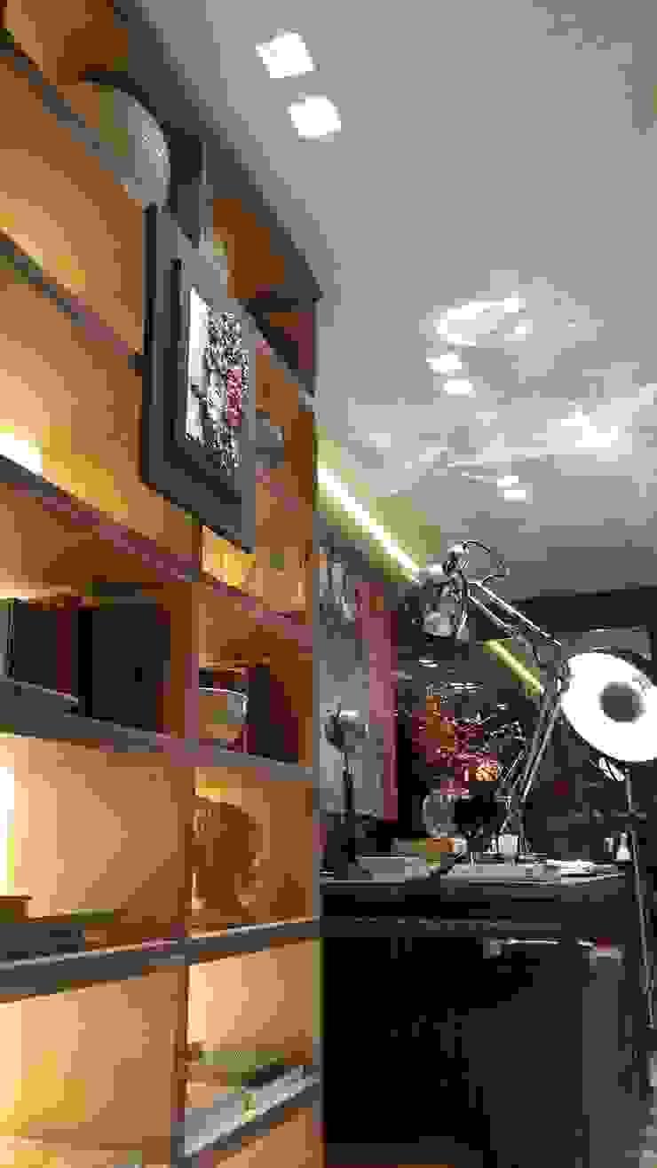 Iluminação bem distribuída valorizando o espaço. por Lucio Nocito Arquitetura e Design de Interiores Moderno
