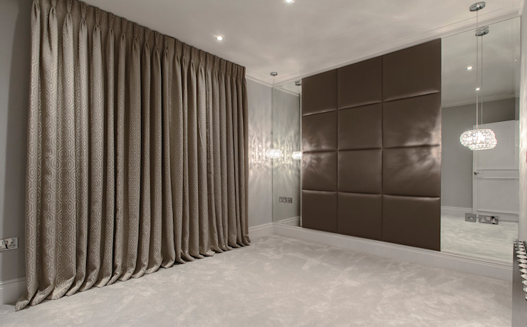 Upholstered wall panels:  Bedroom by Mille Couleurs London,