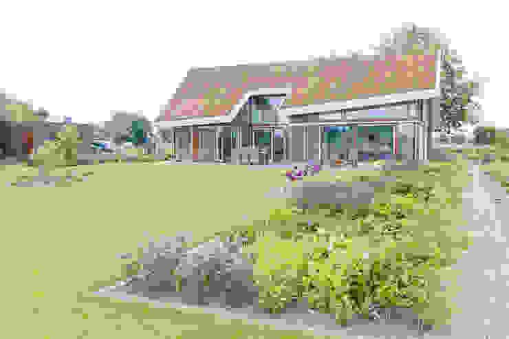 Vaste planten tuin in Houten Moderne tuinen van Dutch Quality Gardens, Mocking Hoveniers Modern