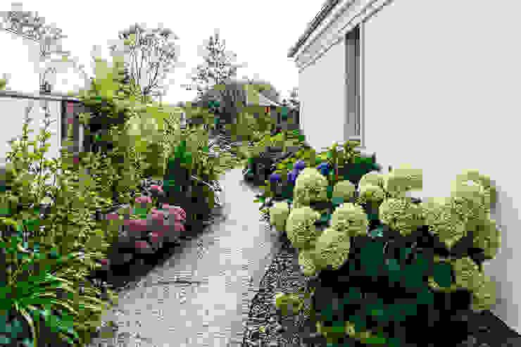Jardines clásicos de Gzowska&Ossowska Pracownie Architektury Wnętrz Clásico