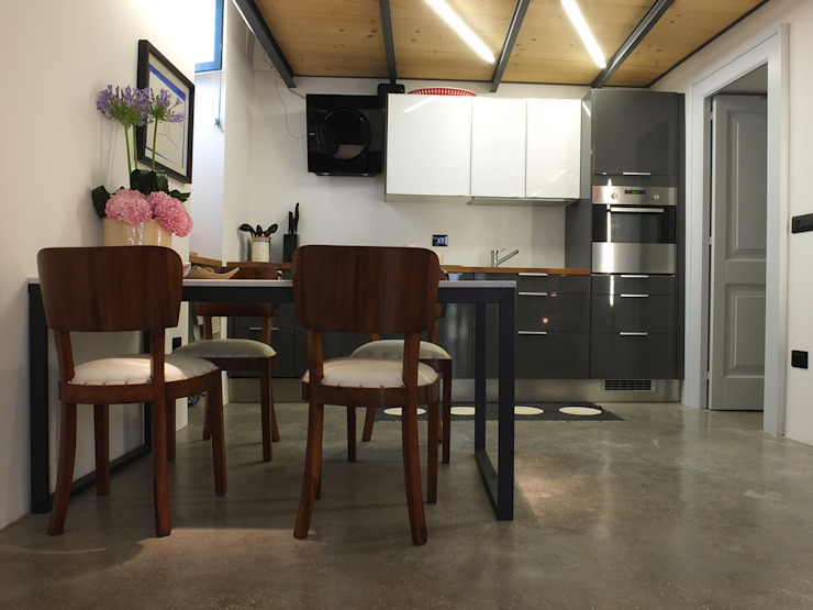 Salas de jantar  por Ossigeno Architettura