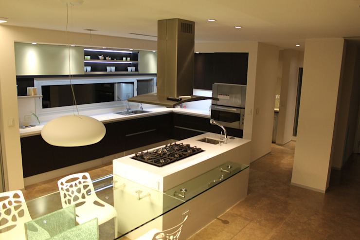 Kitchen by cm espacio & arquitectura srl