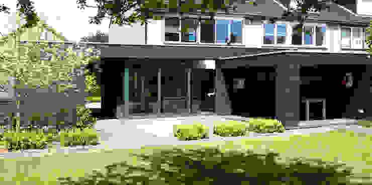 woonkamer, veranda en bijgebouw Moderne woonkamers van Raymond Horstman Architecten BNA Modern Hout Hout