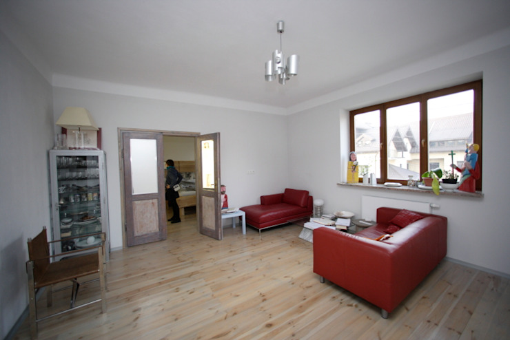 Living room by pracownia architektoniczno-konserwatorska festgrupa, Modern