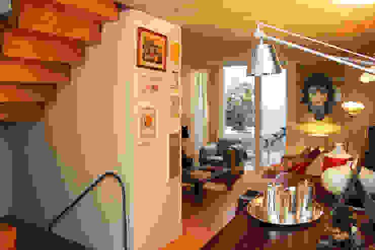 Modern living room by MOOPI - Arch + Interiors Modern
