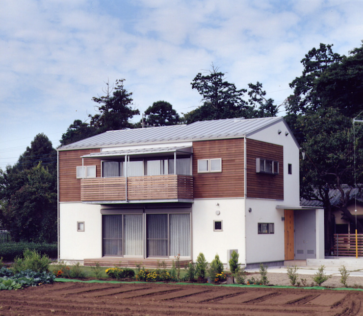Дома в стиле модерн от 池野健建築設計室 Модерн Дерево Эффект древесины