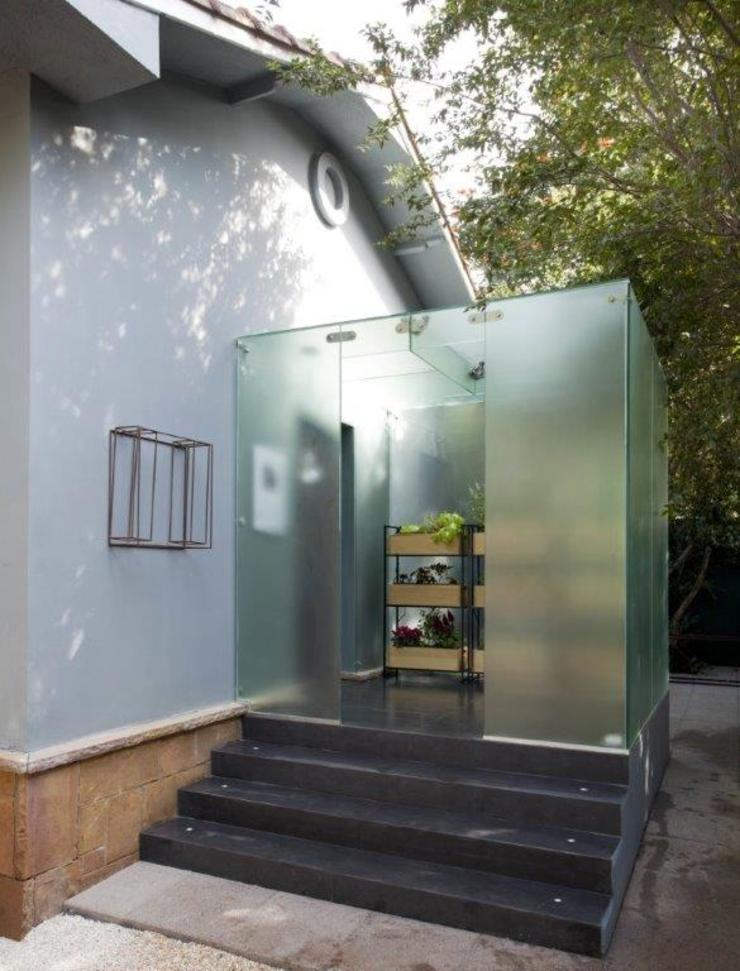 Estufa de vidro na entrada do ambiente Casas escandinavas por Patricia Martinez Arquitetura Escandinavo