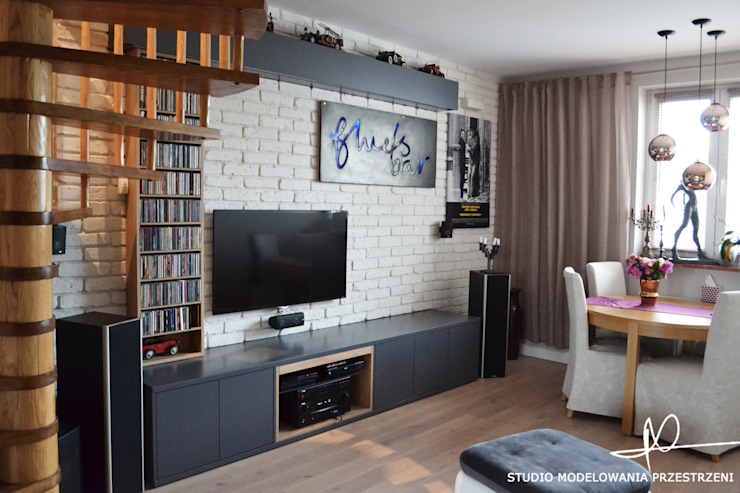 Salas de estar ecléticas por Studio Modelowania Przestrzeni Eclético