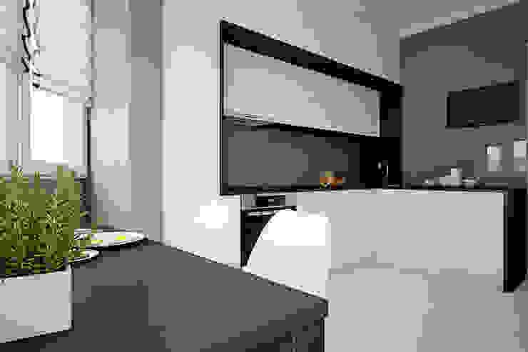 Проект квартиры в монолитном доме Кухня в стиле минимализм от Студия интерьера МЕСТО Минимализм