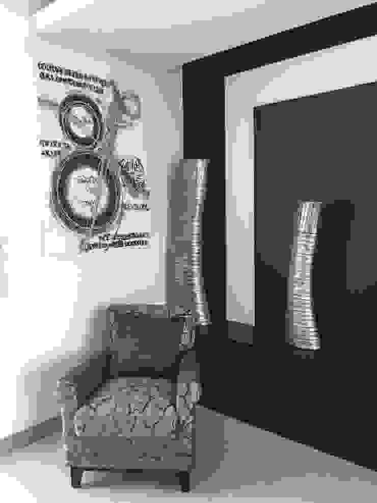 Un sillón con estilo de ARKIZA ARQUITECTOS by Arq. Jacqueline Zago Hurtado Moderno Textil Ámbar/Dorado