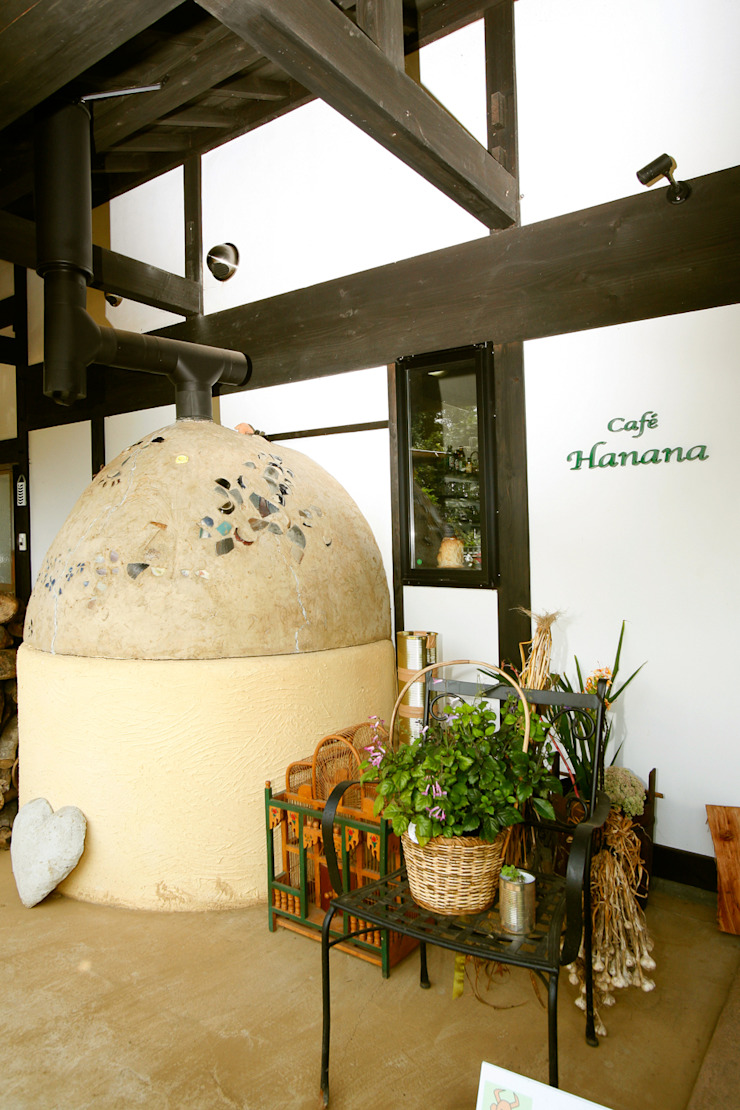 のピザ窯: 吉田建築計画事務所が手掛けたクラシックです。,クラシック