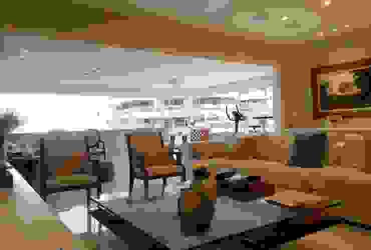 Ambiente clean com a varanda integrada ao living. Salas de estar modernas por Lucio Nocito Arquitetura e Design de Interiores Moderno