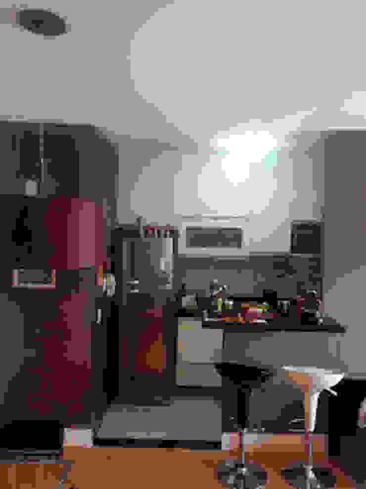 Cozinha americana. Projeto Lucio Nocito Arquitetura para apartamento em Bela Vista SP. Cozinhas ecléticas por Lucio Nocito Arquitetura e Design de Interiores Eclético
