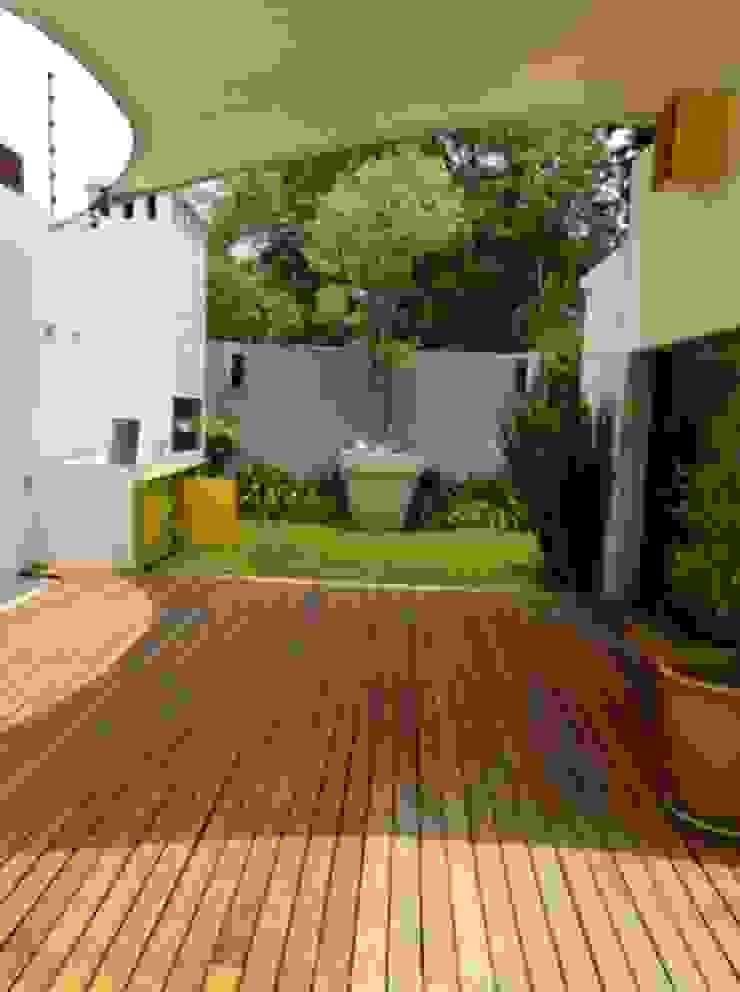 Jardines de estilo moderno de simbiosis ARQUITECTOS Moderno