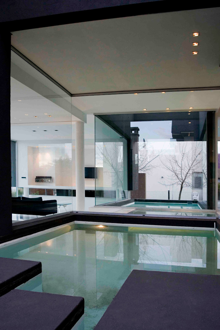 Modern Houses by Remy Arquitectos Modern