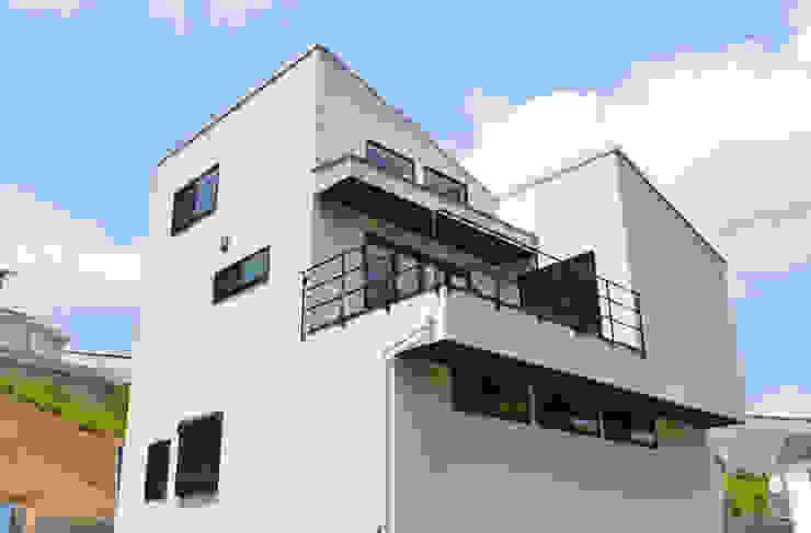 Moderne Häuser von 株式会社スタジオ・チッタ Studio Citta Modern