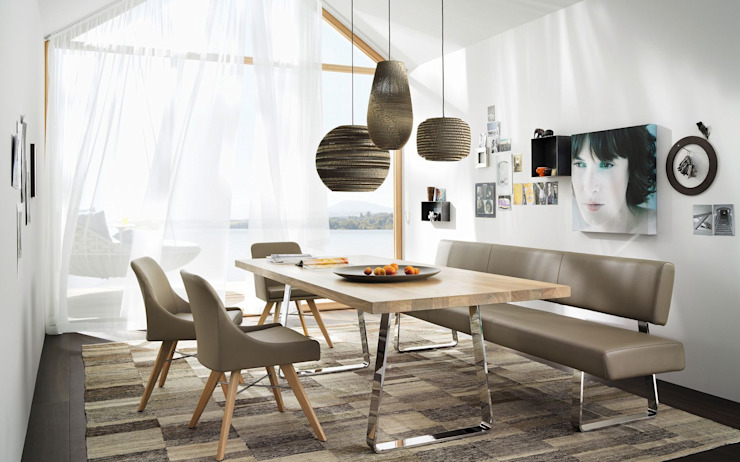 Dining room by Wohndesign Maierhofer