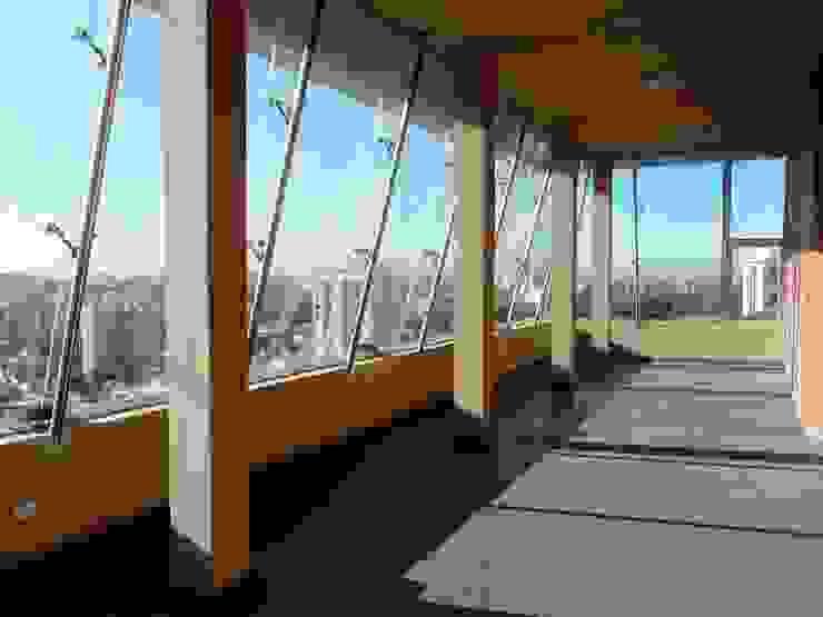 Edificio <q>Del Centenario</q> Gimnasios domésticos modernos: Ideas, imágenes y decoración de Arquitecto Oscar Alvarez Moderno