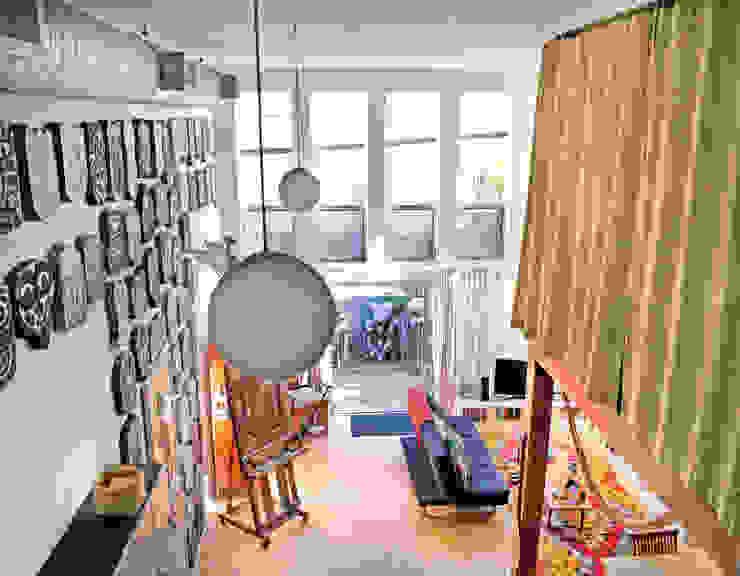 Loft LA Salones modernos de Juan Carlos Loyo Arquitectura Moderno