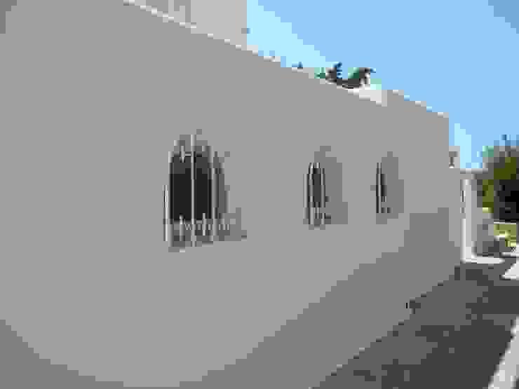 Reparação de fendas e Pintura Exterior Casas mediterrânicas por RenoBuild Algarve Mediterrânico