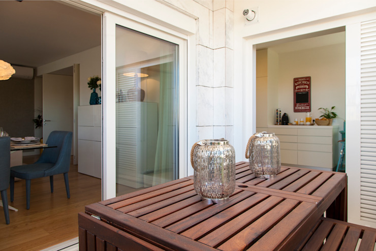 Varanda entre a cozinha e a sala Varandas, marquises e terraços modernos por Traço Magenta - Design de Interiores Moderno