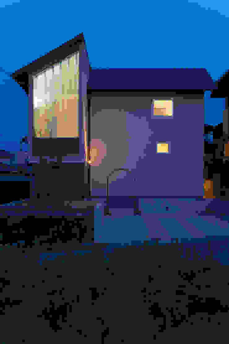 Casas de estilo ecléctico de fabricscape Ecléctico