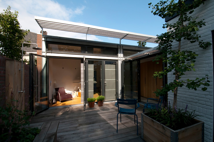gevel uitbreiding werkkamer:  Huizen door JANICKI ARCHITECT