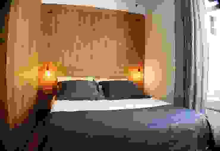 Estudi ramis Camera da letto minimalista