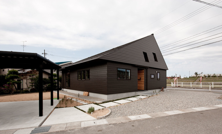 Rustic style house by 有限会社 法澤建築デザイン事務所 Rustic