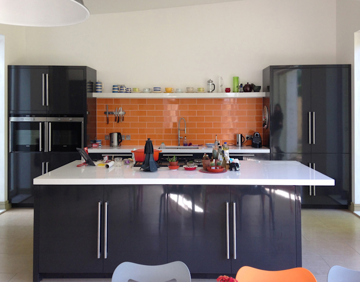 Open Plan Kitchen with Feature Orange Metro Tiles Modern kitchen by ArchitectureLIVE Modern