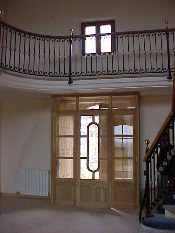 ABAD Y COTONER, S.L. Pasillos, vestíbulos y escaleras de estilo rústico