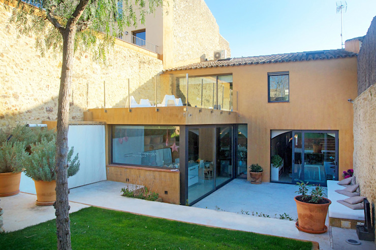 Jardins  por Brick Serveis d'Interiorisme S.L. , Mediterrâneo