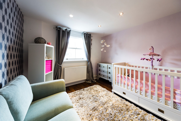Grey-pink-turquoise baby room:  Nursery/kid's room by Affleck Property Services